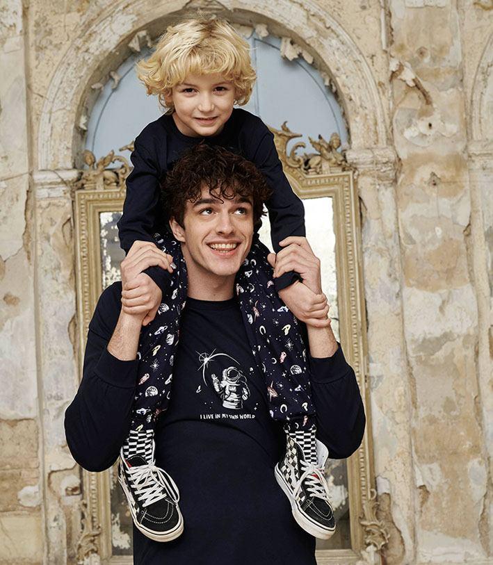 Men and kid wearing pyjamas